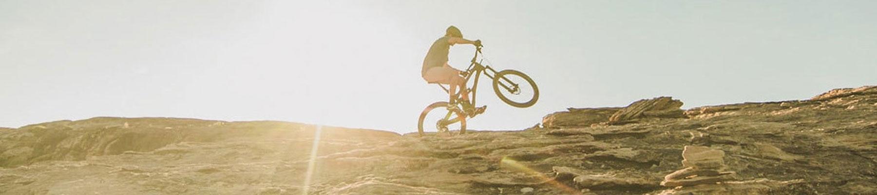 Kulkea Bike Products - Person Mountain Biking in the Sun