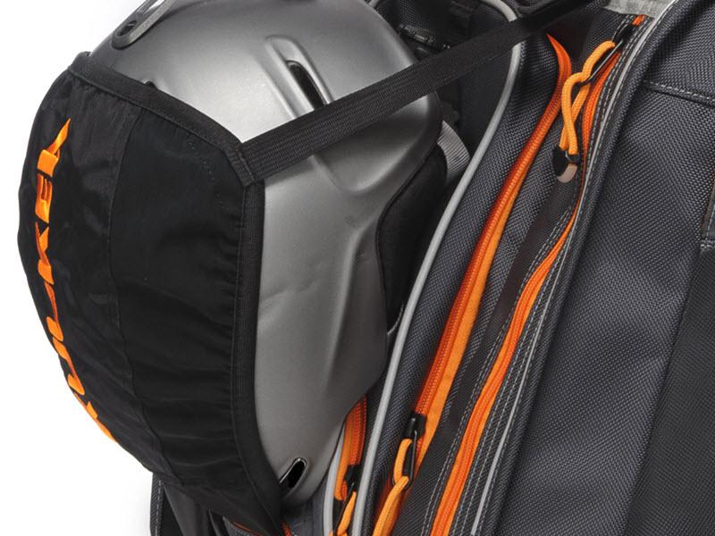 Retractable helmet sling