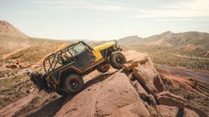 Yellow Jeep on rocks