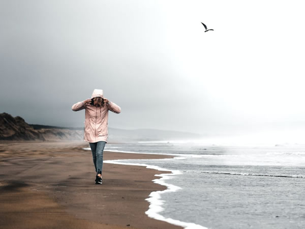 Woman walking on the beach